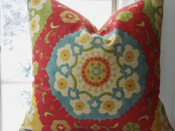 Suzani pillow design shown courtsey of the Cottage Cupboard shop on Etsy.com